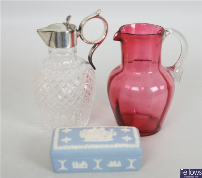 A Victorian cranberry glass jug with clear loop