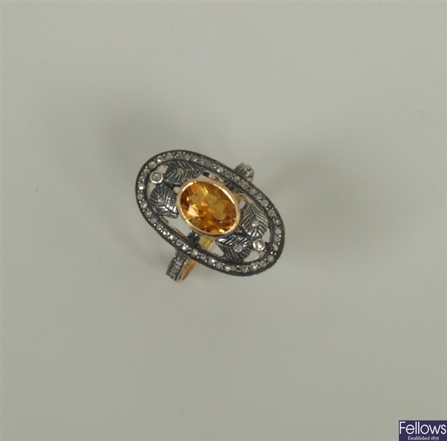 A citrine and diamond set up finger ring, with a