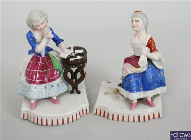 A set of four late 19th century porcelain figures