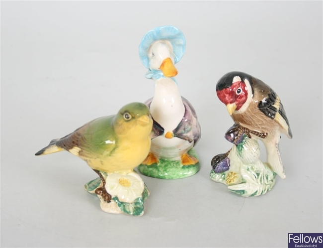 Two small Beswick pottery bird ornaments