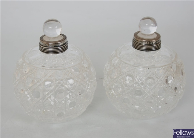 A pair of globular cut glass scent bottles with