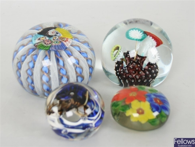 A collection of assorted glass paperweights to