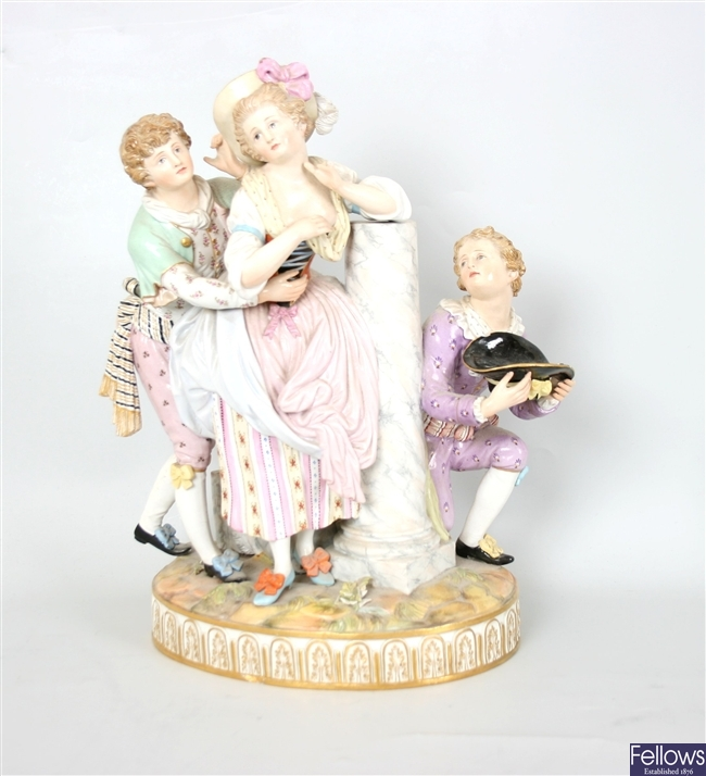 A continental porcelain figure group a male and