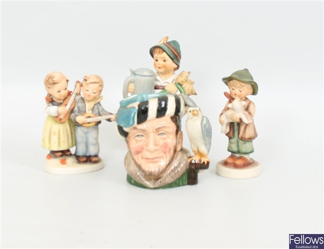 Three Goebel Hummel figurines; together with a