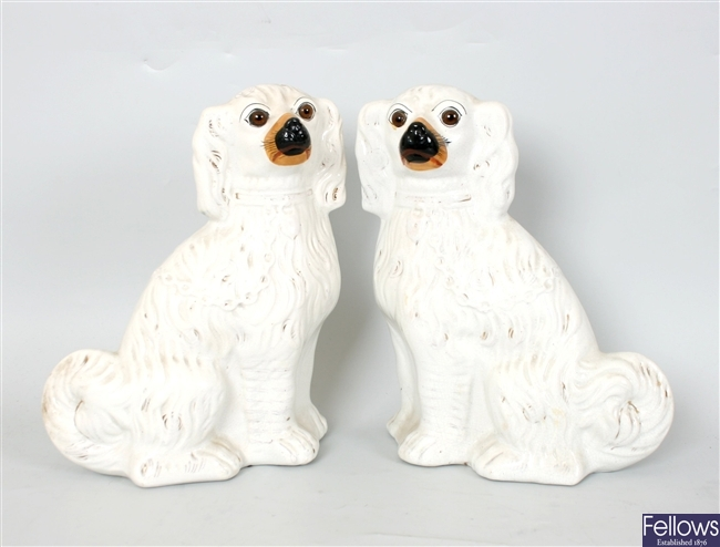 A pair of Victorian white glazed Staffordshire