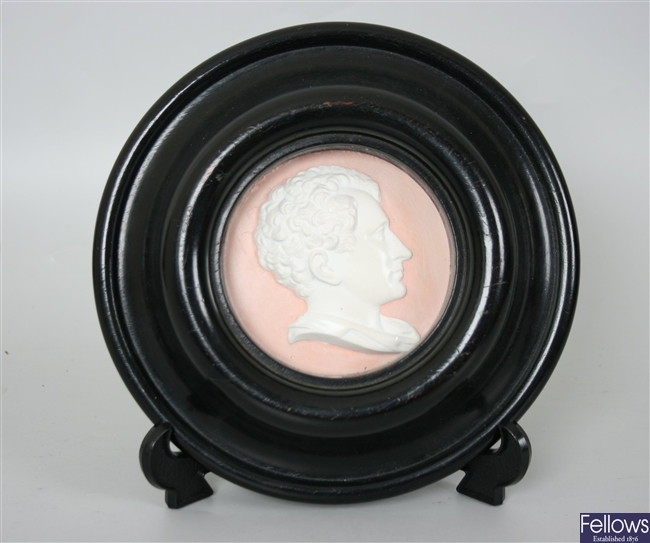 A pair of 19th century cameo style relief