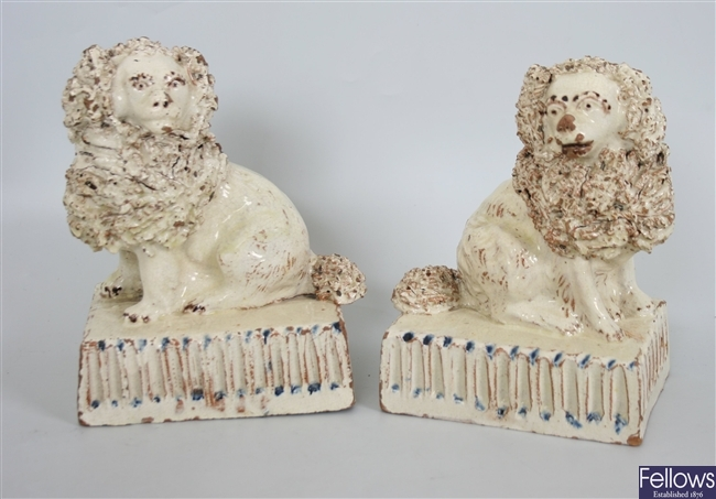 A pair of early 19th century pottery figures of