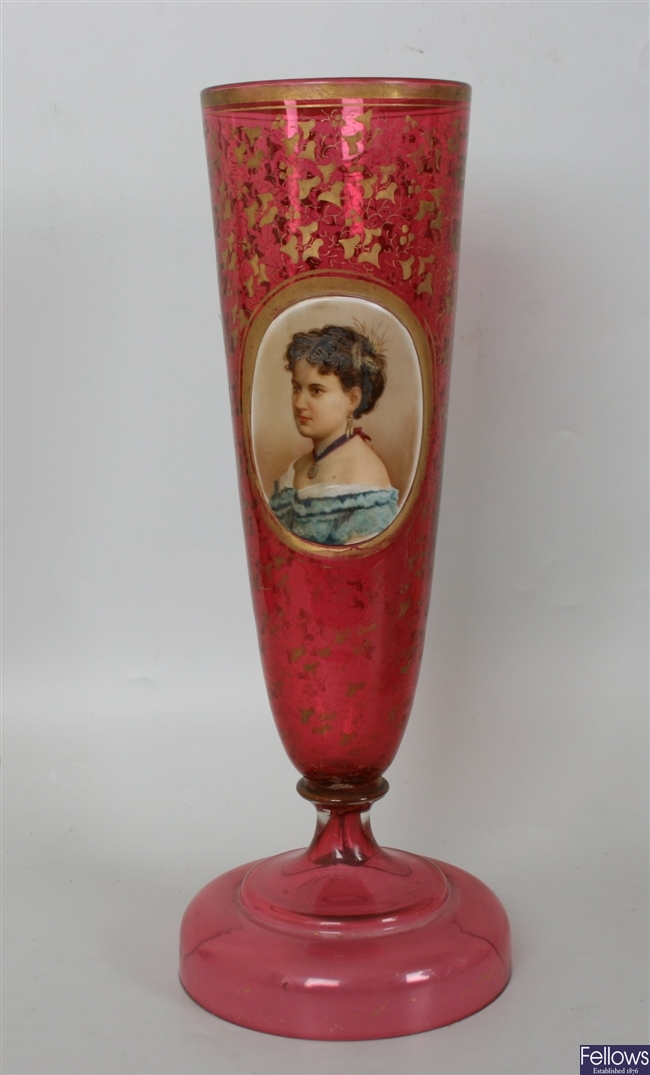 A 19th century cranberry glass vase of flared