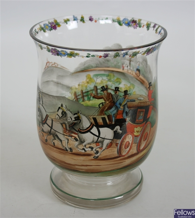 A shaped glass vase with hand painted decoration