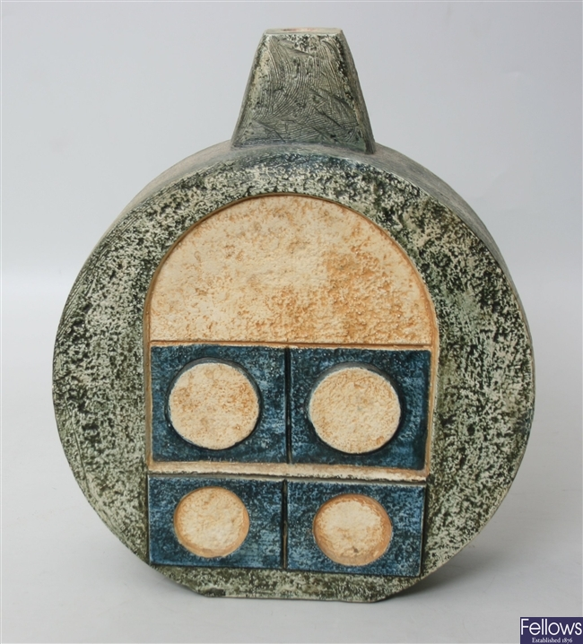 A Troika vase of wheel shape decorated to each
