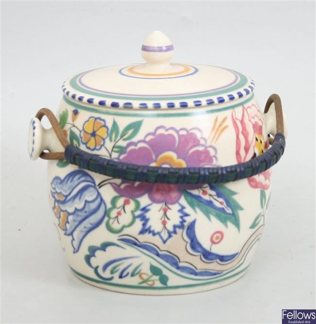A Poole pottery biscuit barrel and cover, with