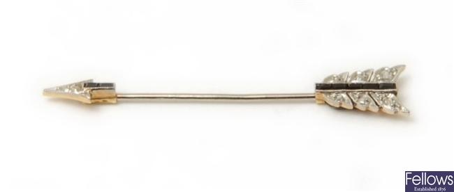 A diamond and black onyx arrow jabot pin, with