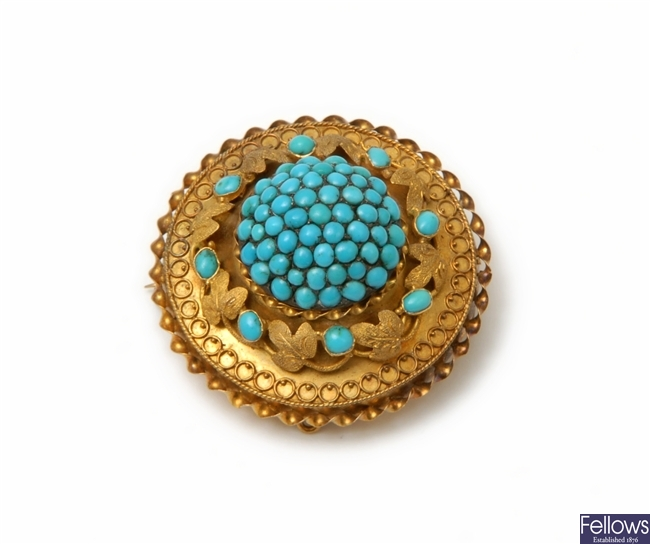 A Victorian turquoise circular brooch with a