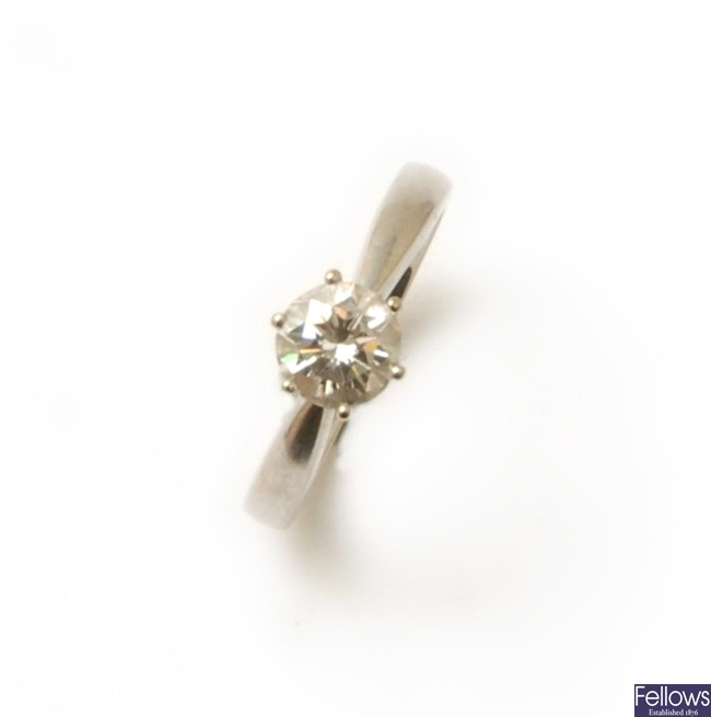 An 18ct white gold single stone round brilliant