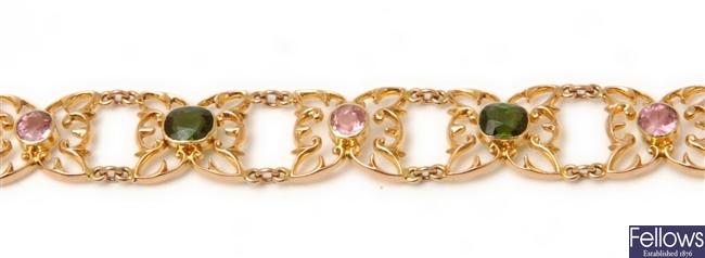 An ornate pink and green tourmaline bracelet,