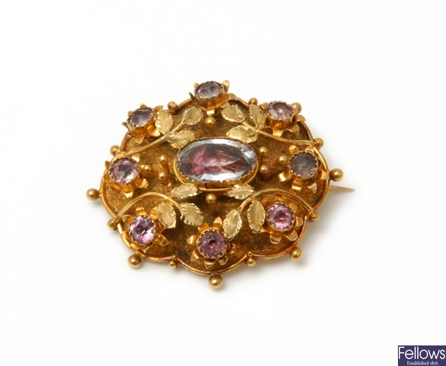 A Victorian cluster brooch with a raised foiled