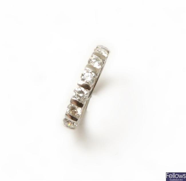 An 18ct white gold seven stone round brilliant
