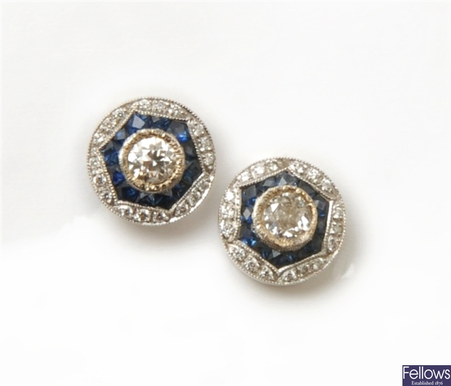 A pair of diamond and sapphire cluster stud