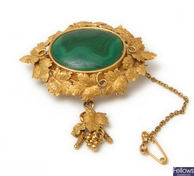 A malachite set floral design brooch, with a