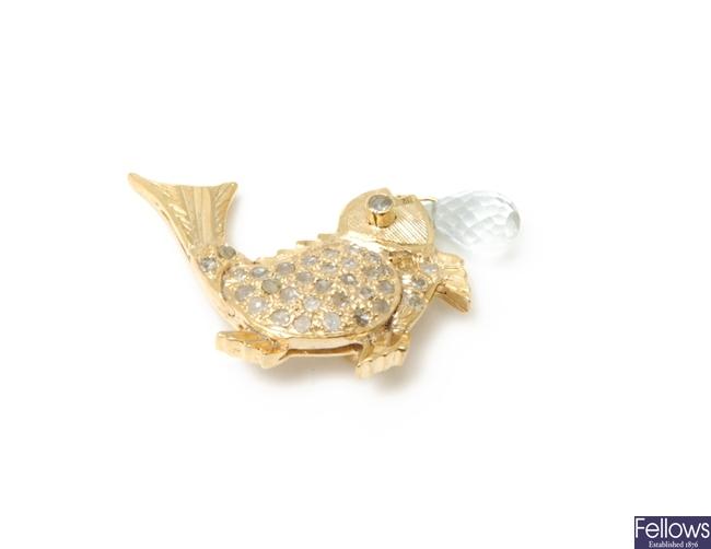 A fish design pendant with a rose cut diamond