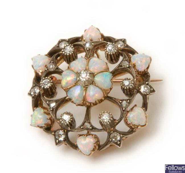 An Edwardian ornate opal and diamond circular