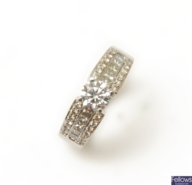 An 18ct white gold diamond ring, with a central