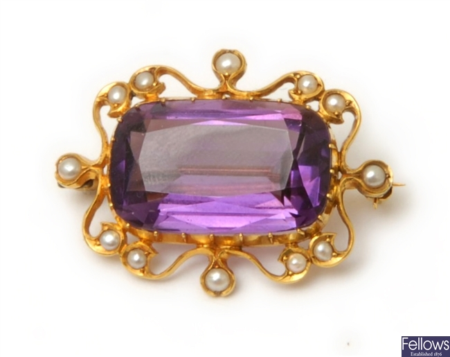 An Edwardian amethyst and spilt pearl brooch,