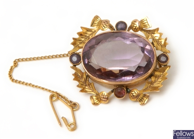 A Victorian amethyst brooch, with a central oval