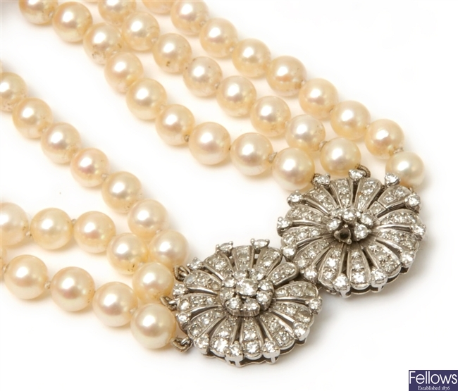 A three row uniform cultured pearl necklace, with
