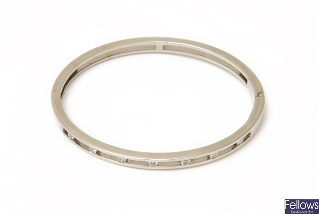 A diamond bangle, the front section seven spaced