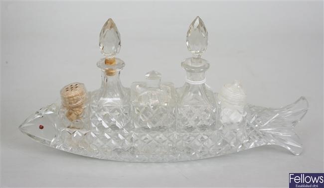 A novelty cut glass cruet set, modeled as a fish,