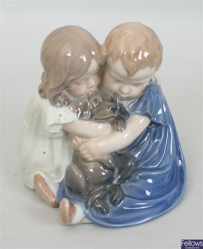 A Royal Copenhagen figure modeled as two seated