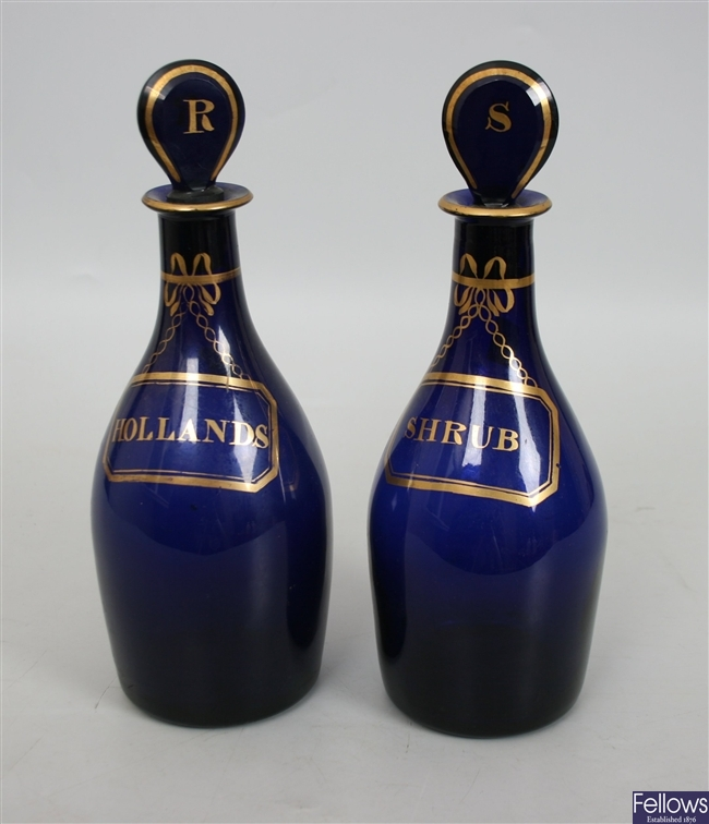 A pair of Bristol blue, bottle shaped decanters