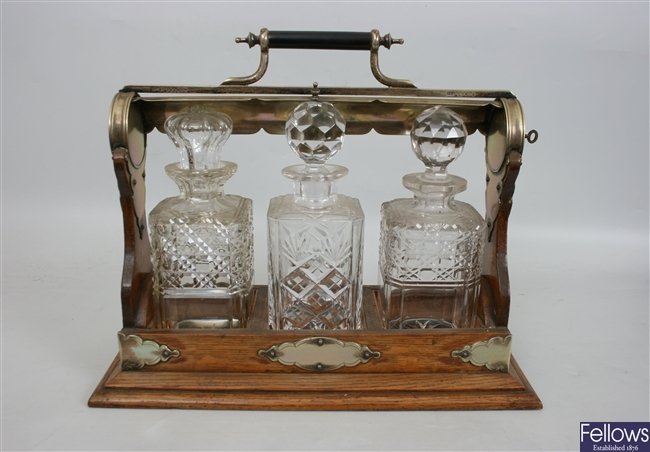 An Edwardian oak and silver plated mounted