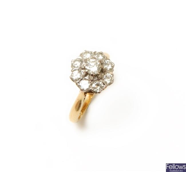 An 18ct gold nine stone diamond ring set round