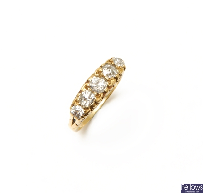 An 18ct gold five stone diamond carved half hoop