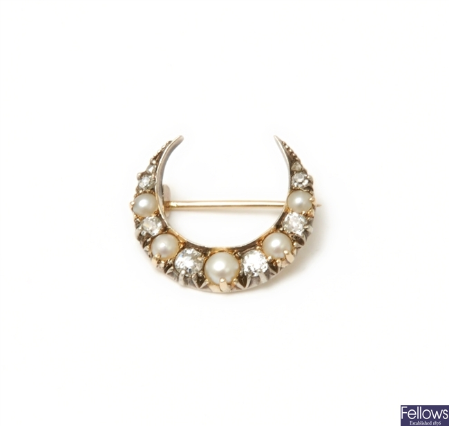 A Victorian crescent brooch with alternating