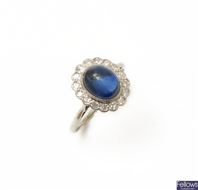 A sapphire and diamond cluster ring with a