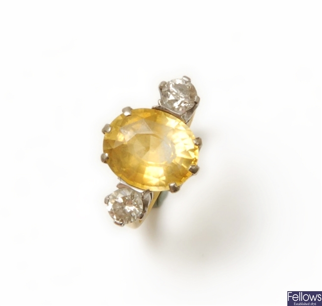 An 18ct gold three stone yellow sapphire and