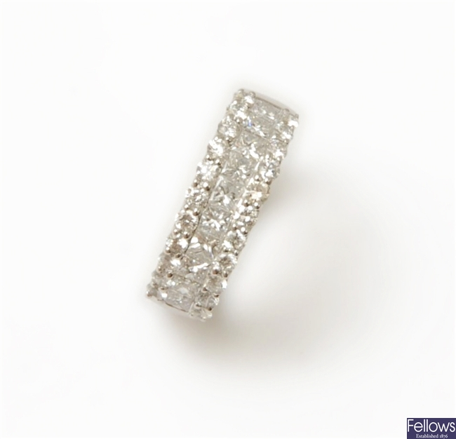 An 18ct white gold diamond band ring, with a