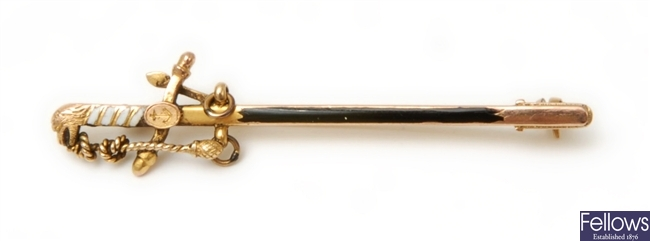 A 9ct gold brooch in the form of a sword, the