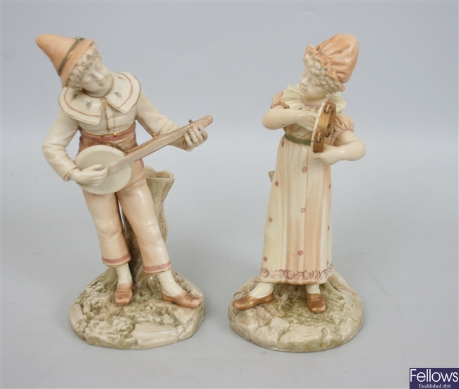 A pair of Royal Worcester bone china figures,