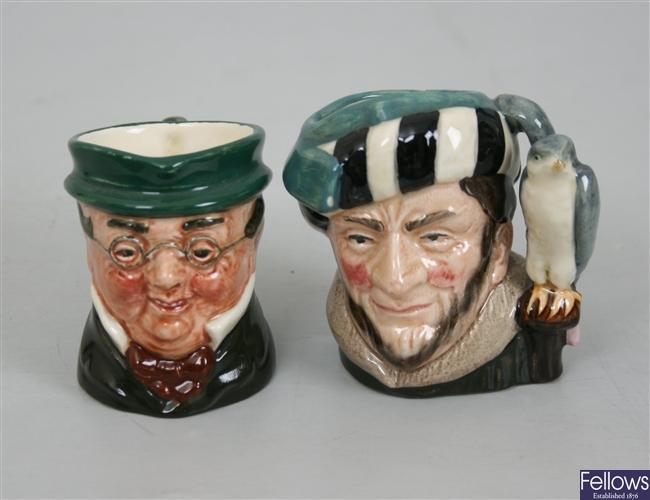 Ten small Royal Doulton pottery character mugs