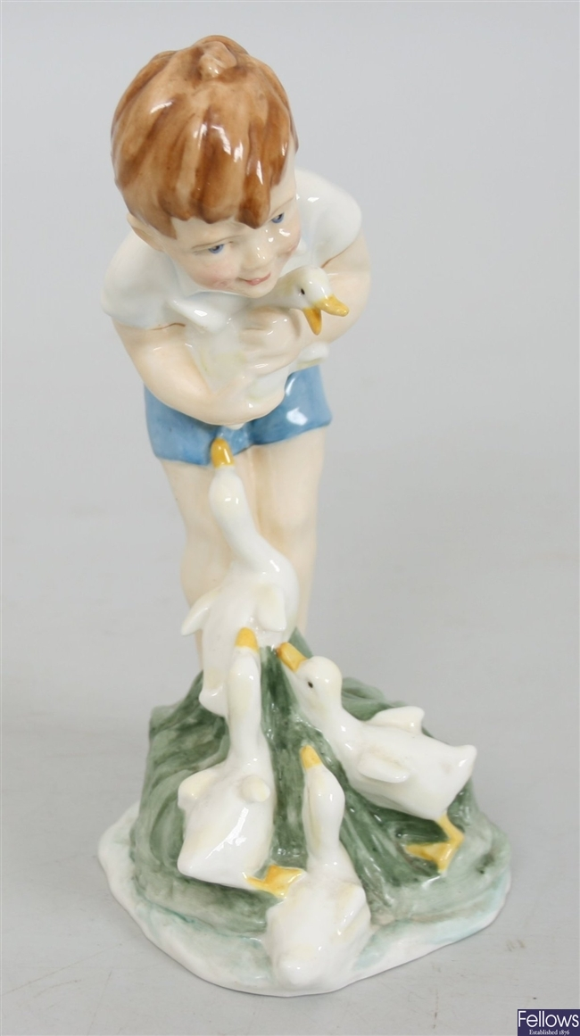 A Royal Worcester figure of a boy holding ducks,