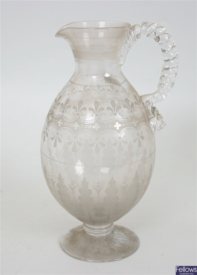 A selection of antique and later decanters and