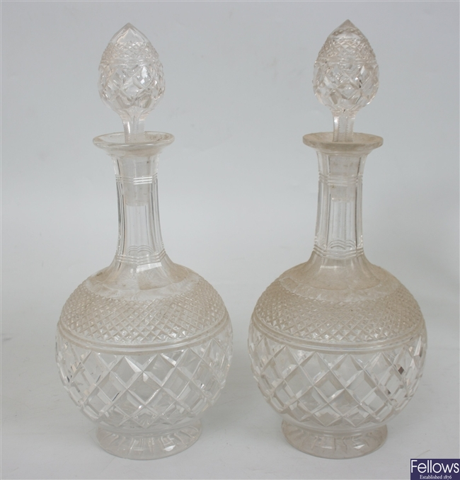 A pair of cut glass bottle shaped decanters with