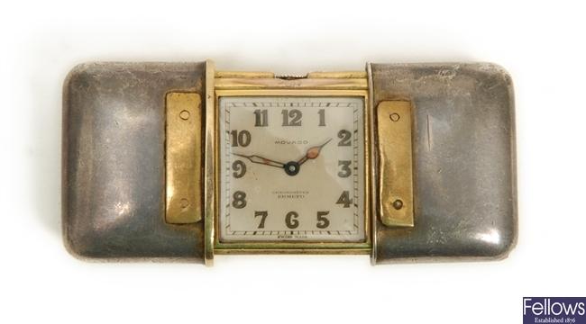 A silver Movado Ermeto travel clock with case