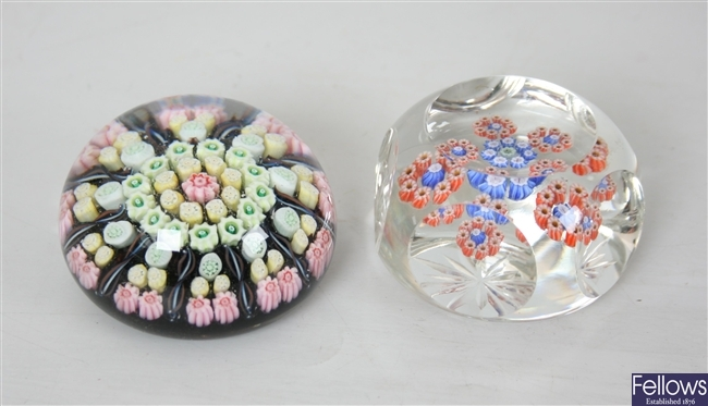 A Milliefiori glass paperweight with twist multi
