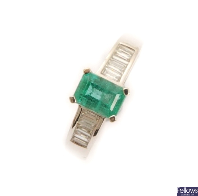 An 18ct white gold emerald and diamond ring,