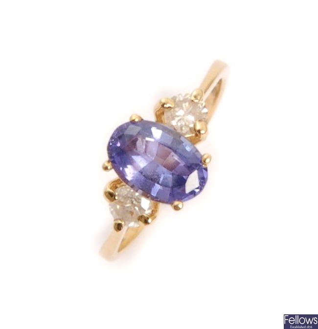 A three stone tanzanite and diamond ring, with a